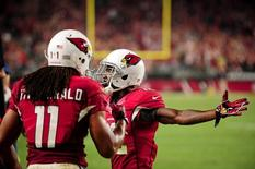 Oct 26, 2015; Glendale, AZ, USA; Arizona Cardinals wide receiver John Brown (12) celebrates with wide receiver Larry Fitzgerald (11) after scoring a 4 yard touchdown during the second half against the Baltimore Ravens at University of Phoenix Stadium. Mandatory Credit: Matt Kartozian-USA TODAY Sports