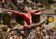 Aug 15, 2015; Indianapolis, IN, USA; Simone Biles competes in the on floor exercise during senior P&G gymnastics championships at Bankers Life Fieldhouse. Mandatory Credit: Marc Lebryk-USA TODAY Sports