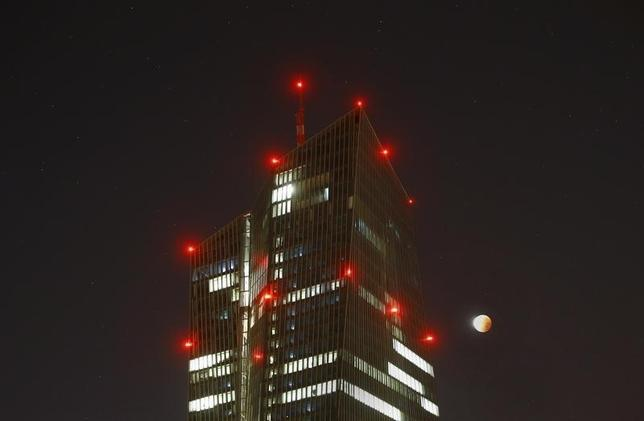 The supermoon is seen next to the air-traffic warning light illuminated headquarters of the European Central Bank (ECB) in Frankfurt, Germany, early morning September 28, 2015. REUTERS/Kai Pfaffenbach
