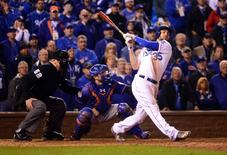 Oct 27, 2015; Kansas City, MO, USA; Kansas City Royals first baseman Eric Hosmer (35) drives in the winning run with a sacrifice fly against the New York Mets in the 14th inning in game one of the 2015 World Series at Kauffman Stadium. Mandatory Credit: Jeff Curry-USA TODAY Sports