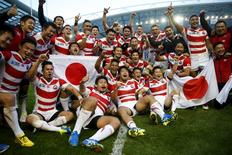 File photo - Rugby Union - South Africa v Japan - IRB Rugby World Cup 2015 Pool B - Brighton Community Stadium, Brighton, England - 19/9/15Japan celebrate victory after the matchTo match Insight RUGBY-UNION-WORLD/GROWTHReuters / Eddie Keogh / FilesLivepic