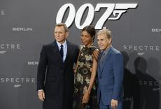 "Actors Daniel Craig, Naomie Harris and Christoph Waltz (L-R) pose for photographers on the red carpet at the German premiere of the new James Bond 007 film ""Spectre"" in Berlin, Germany, October 28, 2015. REUTERS/Fabrizio Bensch"