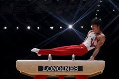 Japan's Kohei Uchimura competes on the Pommel Horse during the men's team final at the World Gymnastics Championships at the Hydro arena in Glasgow, Scotland, October 28, 2015. REUTERS/Phil Noble