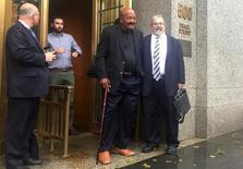 Former NFL running back Jim Brown exits United States District Court with his lawyer Neal Brickman (R) in the Manhattan borough of New York City, October 28, 2015  REUTERS/Nate Raymond