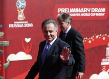 Russian Sports Minister Vitaly Mutko waves as he arrives to the preliminary draw for the 2018 FIFA World Cup at Konstantin Palace in St. Petersburg, Russia July 25, 2015. REUTERS/Maxim Shemetov
