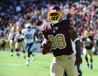 Oct 19, 2014; Landover, MD, USA; Washington Redskins wide receiver Pierre Garcon (88) scores on a 70 yard touchdown catch and run against the Tennessee Titans during the second half at FedEx Field. Mandatory Credit: Brad Mills-USA TODAY Sports