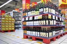 Shelves displaying wines on discount are pictured at a supermarket in Shanghai, China, October 29, 2015.  REUTERS/Aly Song