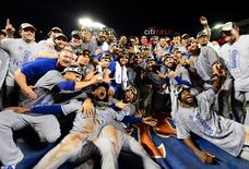 Kansas City Royals players pose for a team photo after defeating the New York Mets in game five of the World Series at Citi Field in New York, November 1, 2015. The Royals won the World Series four games to one. Mandatory Credit: Jeff Curry-USA TODAY Sports
