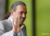 Sheikh Ahmad Al-Fahad Al-Sabah of Kuwait waves as he takes a break during an extraordinary meeting of the FIFA Executive Committee in front of FIFA's headquarters in Zurich, Switzerland October 20, 2015.    REUTERS/Arnd Wiegmann