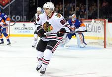 Chicago Blackhawks right wing Patrick Kane (88) skates against the New York Islanders during the third period at Barclays Center. The Blackhawks defeated the Islanders 3-2 in overtime. Mandatory Credit: Brad Penner-USA TODAY Sports