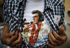 An Elvis Presley fan shows his T-shirt at the four-day Collingwood Elvis Festival in Collingwood, Ontario July 25, 2015. REUTERS/Chris Helgren