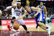 Nov 6, 2015; Cleveland, OH, USA; Cleveland Cavaliers guard Mo Williams (52) and Philadelphia 76ers guard T.J. McConnell (12) go for a loose ball during the third quarter at Quicken Loans Arena. The Cavs won 108-102. Ken Blaze-USA TODAY Sports
