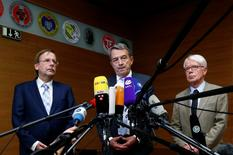 Rainer Koch, vice president of the German Football Association (DFB), Wolfgang Niersbach, president of the DFB and President of the German Soccer Federation (DFL) Reinhard Rauball (L-R) make a statement to the media at the DFB headquarters in Frankfurt, Germany November 9, 2015. REUTERS/Ralph Orlowski