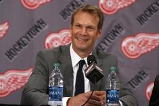 Detroit Red Wings defenseman Nicklas Lidstrom answers questions after announcing his retirement from NHL hockey during a news conference at Joe Louis Arena in Detroit, Michigan May 31, 2012.  REUTERS/Rebecca Cook