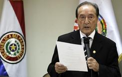 Acting President of the South American Soccer Federation (CONMEBOL) Eugenio Figueredo gives his first news conference since taking charge after the resignation of former President Nicolas Leoz, in Asuncion April 30, 2013.  REUTERS/Jorge Adorno