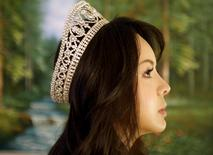 Miss World Canada Anastasia Lin poses with her crown after an interview at her home in Toronto, Ontario November 10, 2015. REUTERS/Chris Helgren