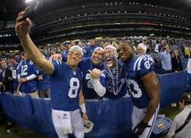 Jan 4, 2015; Indianapolis, IN, USA; Indianapolis Colts players Matt Hasselbeck (8) and Dwayne Allen (83) take a selfie photo with fans after the 2014 AFC Wild Card playoff football game against the Cincinnati Bengals at Lucas Oil Stadium. Mandatory Credit: Kirby Lee-USA TODAY Sports