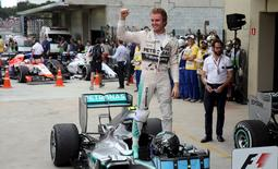 Mercedes Formula One driver Nico Rosberg of Germany celebrates after winning the Brazilian F1 Grand Prix in Sao Paulo, Brazil, November 15, 2015.    REUTERS/Nacho Doce