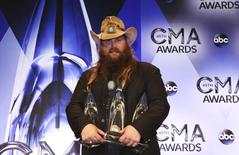 Musician Chris Stapleton poses backstage with his awards for Male Vocalist of the Year, New Artist of the Year and Album of the Year for Traveller during the 49th Annual Country Music Association Awards in Nashville, Tennessee November 4, 2015.  REUTERS/Jamie Gilliam