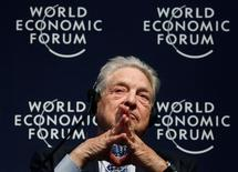 George Soros, attends a session at the World Economic Forum (WEF) in Davos, January 27, 2011.  REUTERS/Christian Hartmann