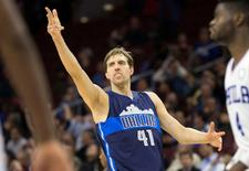 Nov 16, 2015; Philadelphia, PA, USA; Dallas Mavericks forward Dirk Nowitzki (41) reacts to a three pointer against the Philadelphia 76ers during the second half at Wells Fargo Center. The Mavericks won 92-86. Mandatory Credit: Bill Streicher-USA TODAY Sports