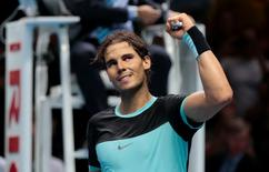 Tennis - Barclays ATP World Tour Finals - O2 Arena, London - 18/11/15 Men's Singles - Rafael Nadal of Spain celebrates winning his match against Andy Murray of Great Britain Reuters / Suzanne Plunkett Livepic