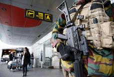 A Belgian soldier stands guard at the entrance of Zaventem international airport near Brussels, November 22, 2015, after security was tightened in Belgium following the fatal attacks in Paris.     REUTERS/Francois Lenoir