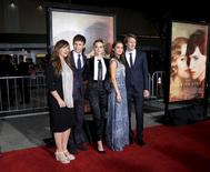 "Screenwriter Lucinda Coxon, cast members Eddie Redmayne, Amber Heard and Alicia Vikander, and director\producer Tom Hooper (L-R) pose during the premiere of the film ""The Danish Girl"" in Los Angeles, California November 21, 2015. REUTERS/Kevork Djansezian"