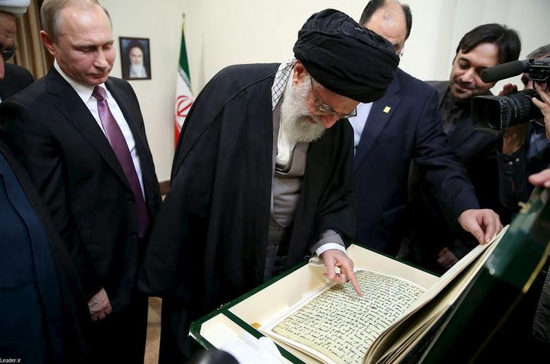Iran's Supreme Leader Ayatollah Ali Khamenei (C) receives a gift from Russia's President Vladimir Putin (L) in Tehran November 23, 2015. REUTERS/leader.ir/Handout via Reuters