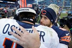 Nov 22, 2015; Chicago, IL, USA; Chicago Bears quarterback Jay Cutler (6) talks with Denver Broncos quarterback Brock Osweiler (17) after the NFL game at Soldier Field. Mandatory Credit: Kamil Krzaczynski-USA TODAY Sports