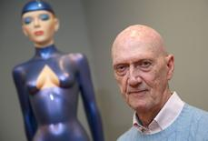 "Artist Allen Jones poses for a portrait next to his work The Blue Gymnast (2015) at a preview of his exhibition ""Colour Matters"" in London, Britain November 24, 2015. The show runs from November 25 to January 23 at the Marlborough Gallery in London. REUTERS/Neil Hall"