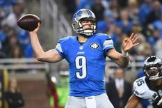 Nov 26, 2015; Detroit, MI, USA; Detroit Lions quarterback Matthew Stafford (9) drops back to pass during the first quarter of a NFL game on Thanksgiving against the Philadelphia Eagles at Ford Field. Mandatory Credit: Tim Fuller-USA TODAY Sports