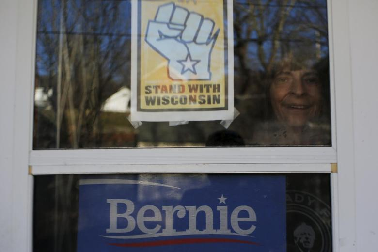 Retired IBEW member and supporter of U.S. Democratic presidential candidate Bernie Sanders Linda Horan looks out from her front door in Alstead, New Hampshire November 17, 2015.  REUTERS/Brian Snyder