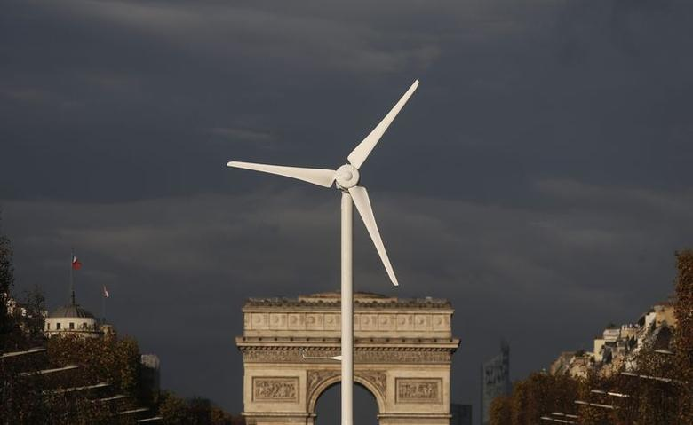A power-generating windmill turbine is seen in front of the Arc de Triomphe on the Champs Elysees avenue in Paris ahead of the COP21 World Climate Summit, France, November 25, 2015.  REUTERS/Christian Hartmann