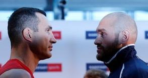 Boxing - Wladimir Klitschko & Tyson Fury Weigh-In - Karstadt Sports Essen, Germany - 27/11/15   Wladimir Klitschko and Tyson Fury go head to head during the Weigh-In Action Images via Reuters / Lee Smith