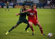 Portland Timbers defender/midfielder Rodney Wallace (22) and FC Dallas defender Walker Zimmerman (25) fight for the ball in the first half of leg two of the Western Conference championship at Toyota Stadium. Jerome Miron-USA TODAY Sports