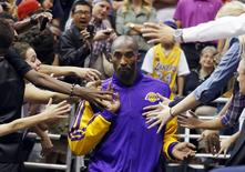 Kobe Bryant walks past fans during a game against the Utah Jazz in Salt Lake City, Utah, November 7, 2012. REUTERS/Jim Urquhart
