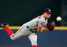 Washington Nationals starting pitcher Jordan Zimmermann (27) delivers a pitch to an Atlanta Braves batter in the first inning of their game at Turner Field. Mandatory Credit: Jason Getz-USA TODAY Sports