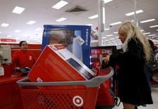 Nancy Villagomez pays for her purchases during Black Friday Shopping at a Target store in Chicago, Illinois, United States, November 27, 2015. REUTERS/Jim Young