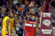 Washington Wizards guard John Wall (2) celebrates after scroing during the fourth quarter against the Cleveland Cavaliers at Quicken Loans Arena. The Wizards won 97-85. Mandatory Credit: Ken Blaze-USA TODAY Sports
