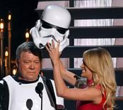 "Show host Carrie Underwood removes the helmet off a ""Star Wars"" Storm Trooper, revealing that actor William Shatner of ""Star Trek"" fame was inside, onstage at the 49th Annual Country Music Association Awards in Nashville, Tennessee in this November 4, 2015 file photo.  REUTERS/Harrison McClary/Files"