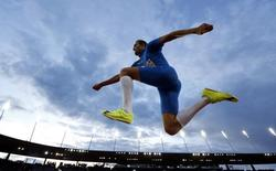 Fabrizio Donato of Italy competes in the men's triple jump final during the European Athletics Championships at the Letzigrund Stadium in Zurich in this August 14, 2014 file photo.  REUTERS/Phil Noble
