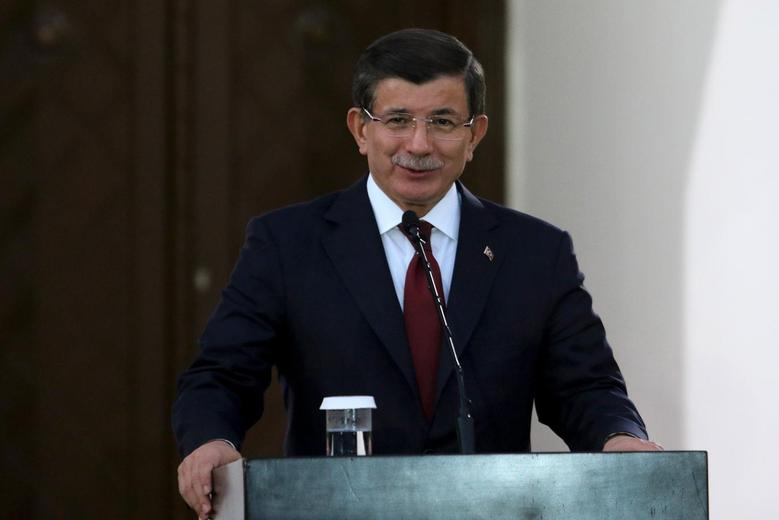 Turkish Prime Minister Ahmet Davutoglu  speaks to the media during a visit to northern Cyprus, December 1, 2015.  REUTERS/Yiannis Kourtoglou -