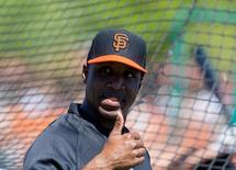 San Francisco Giants former outfielder Barry Bonds reacts during batting practice prior to the game against the Chicago Cubs at Scottsdale Stadium. Mark J. Rebilas-USA TODAY Sports