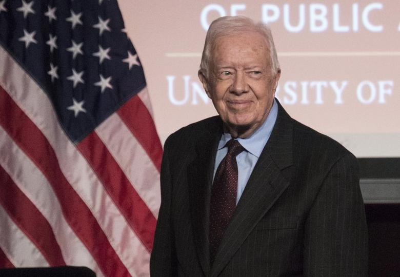 Former U.S. President Jimmy Carter arrives to speak during an event honoring former U.S. Vice President Walter Mondale hosted by the Humphrey School of Public Affairs at the University of Minnesota in Washington October 20, 2015. REUTERS/Joshua Roberts