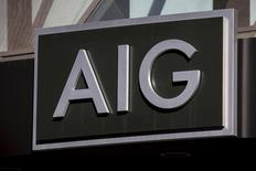 The AIG logo is seen at its building in New York's financial district March 19, 2015. American International Group Inc shareholders will seek final approval of $970.5  REUTERS/Brendan McDermid