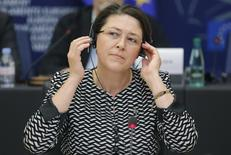 Violeta Bulc of Slovenia adjusts her hearphones as she addresses the European Parliament's Committee on Transport and Tourism at the EU Parliament in Strasbourg, October 20, 2014. REUTERS/Christian Hartmann