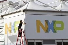 A man works on a tent for NXP Semiconductors in preparation for the 2015 International Consumer Electronics Show (CES) at Las Vegas Convention Center in Las Vegas, Nevada January 4, 2015.  REUTERS/Steve Marcus