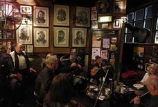 Musicians play Irish traditional music in a pub in central Dublin November 21, 2010. REUTERS/Cathal McNaughton