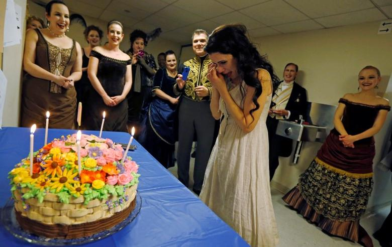 Performer Ana Maria Martinez wipes away tears as she is presented with a birthday cake during a break of the performance of ''Rusalka'' at the Lyric Opera in Chicago, March 10, 2014. REUTERS/Jim Young